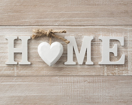 New home sign on wooden background